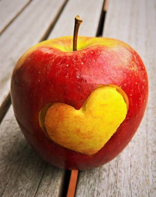 Closeup Photo of Apple Fruit Carved With Heart
