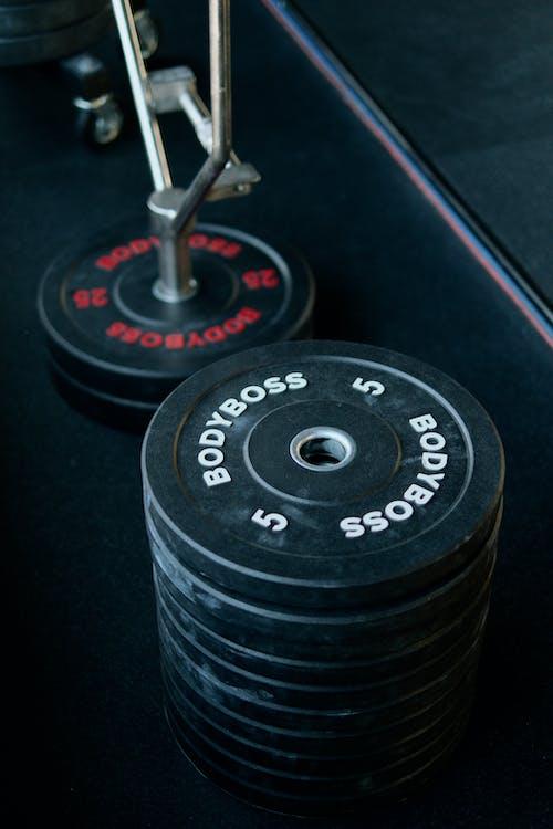 Kostenloses Stock Foto zu fitnessgeräte, gewicht, gewichte