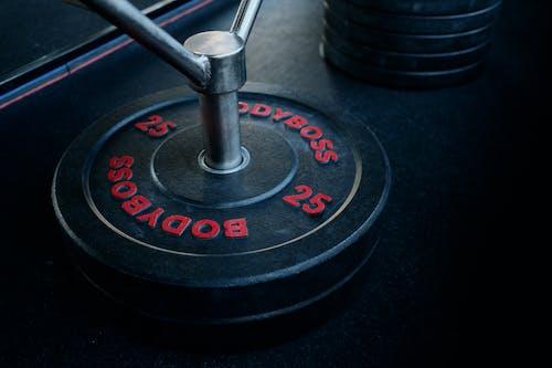 Kostenloses Stock Foto zu fitnessgeräte, fitnessstudio, gewicht