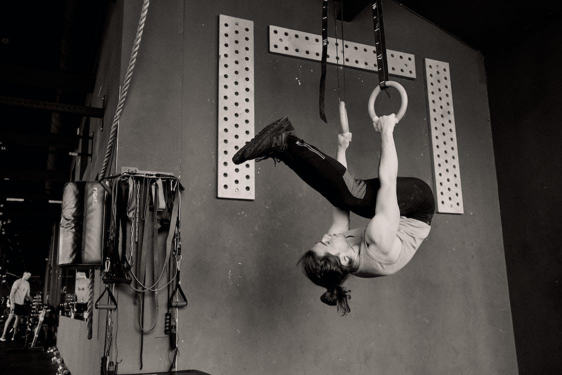 Upside Down Man Exercising on Gymnastic Rings