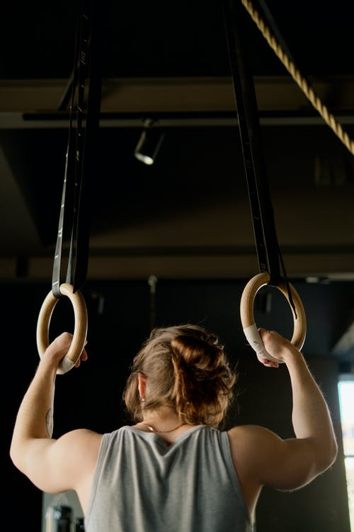 Person Holding Gymnastic Rings