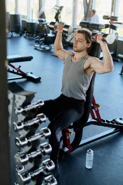 Man Exercising at a Gym