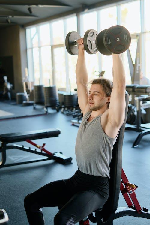 Man Exercising at a Gym