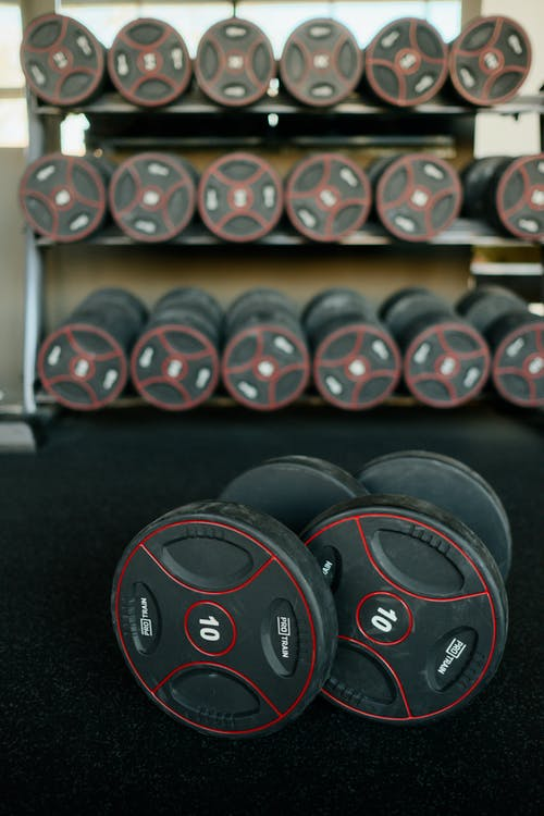 Black and Red Dumbbells on Rack