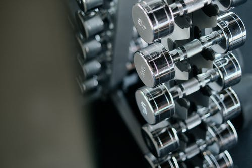 Silver Dumbbells on Black Steel Rack