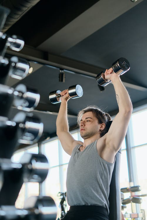 Man in Gray Tank Top Exercising