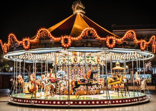 A Carousel in the Amusement Park at Night