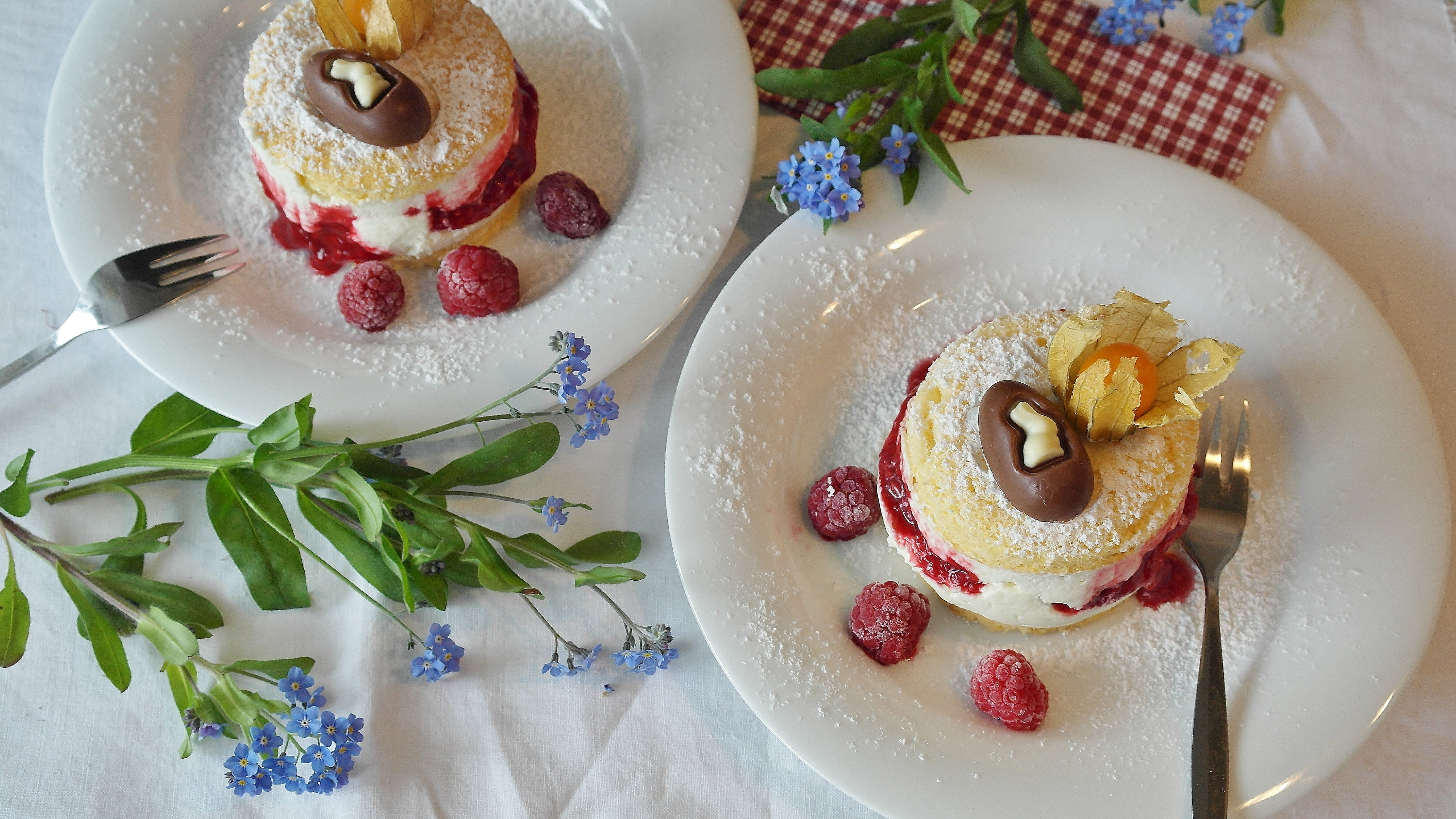 Two Strawberry Cakes on Plates