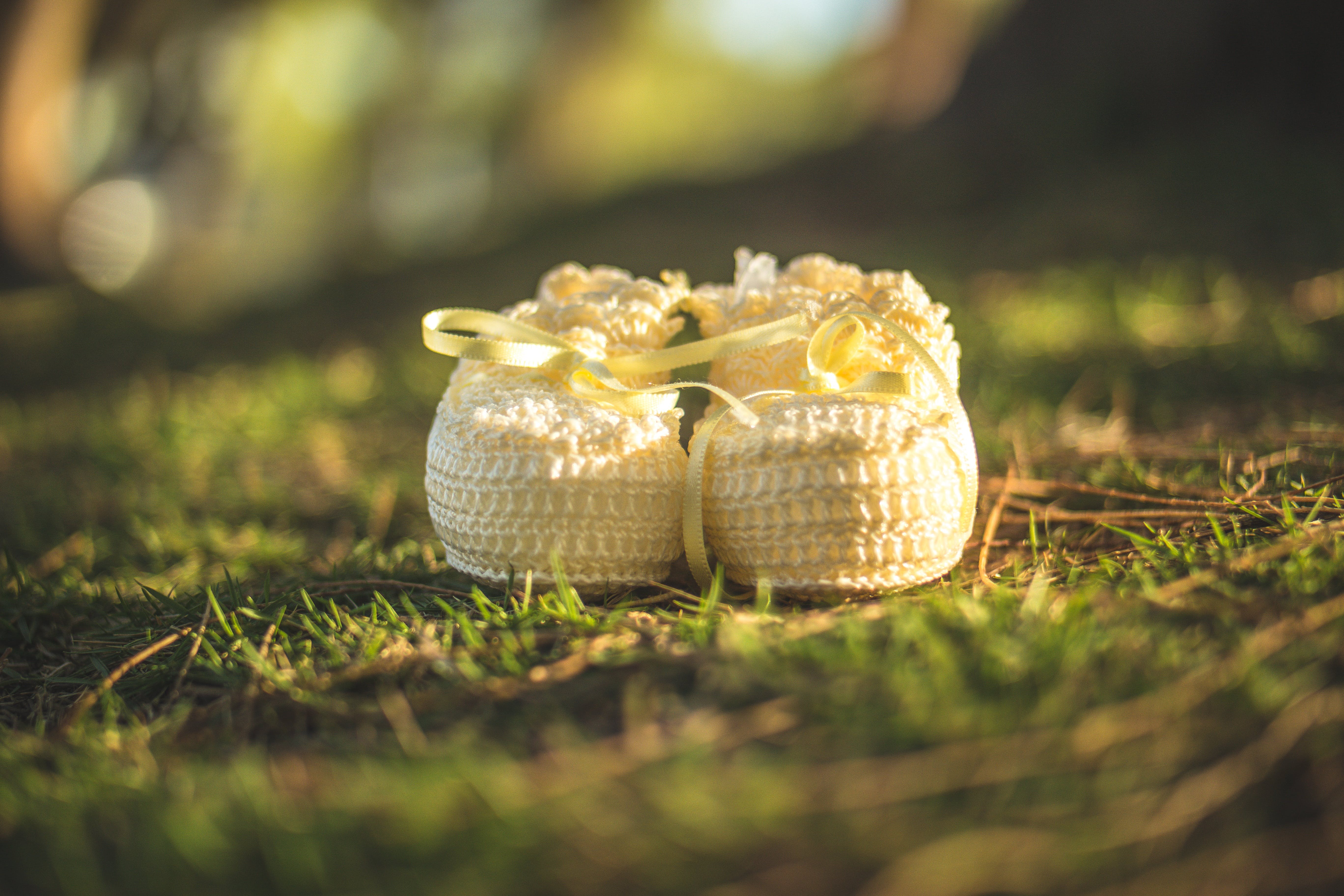 White Crochet Shoes on Grass Field