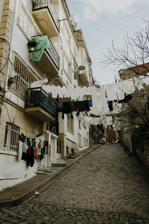 Old narrow street with clothes drying on clothesline