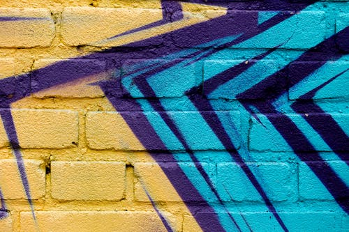 Close-Up Shot of a Graffiti on the Brick Wall