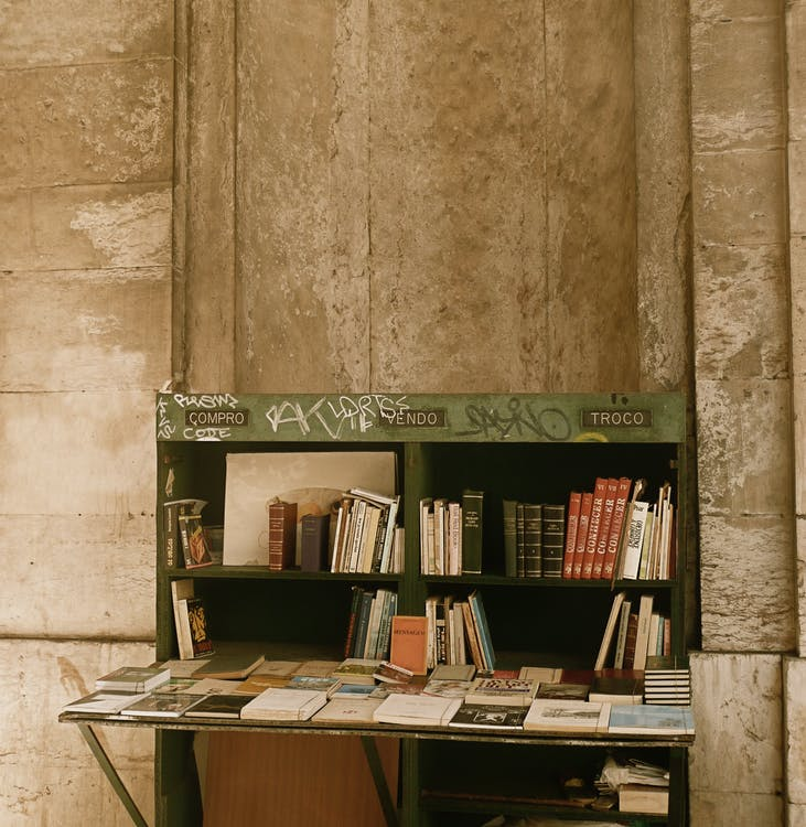 Stack of books on desk on street