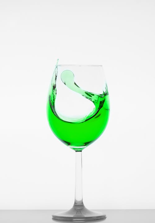 Drinking Glass Filled With Green Liquid