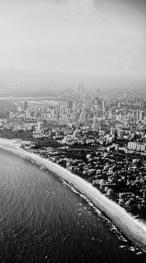 Grayscale Photo of a Coastal City