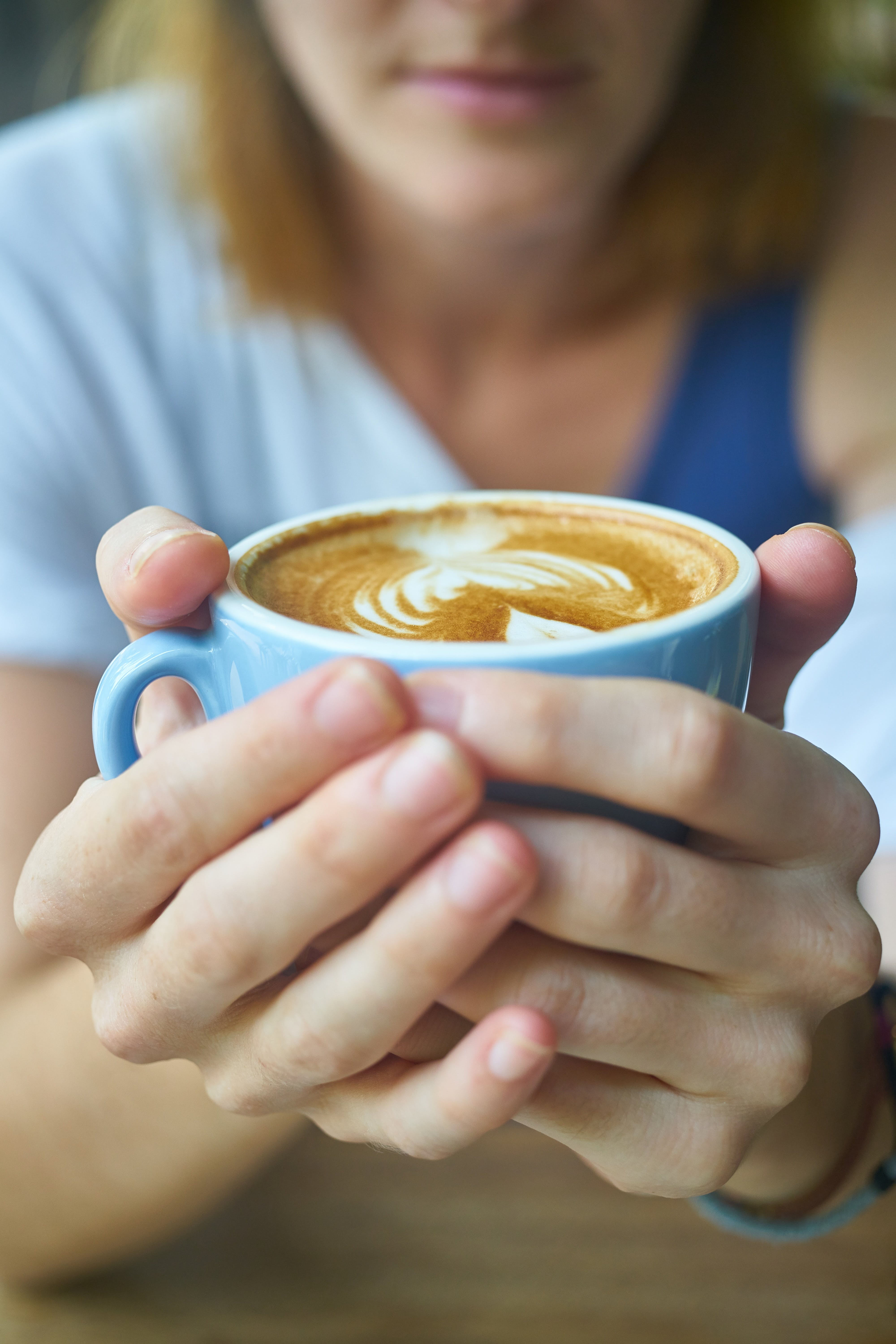 Person Holding Cup of Latte