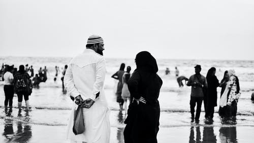 Grayscale Photo of People at the Beach