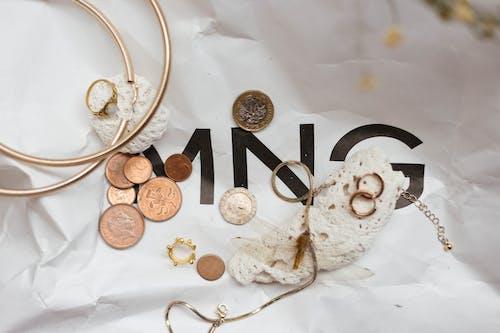 Free stock photo of brand, coins, rock sea, white rock