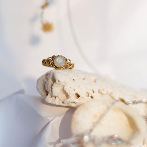 Gold Diamond Ring on White Textile