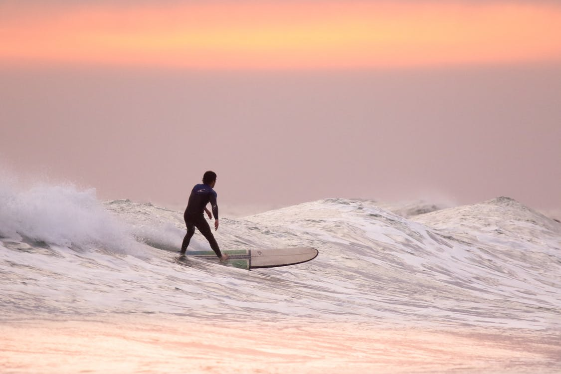 Man Doing Surfing at Golden Hour