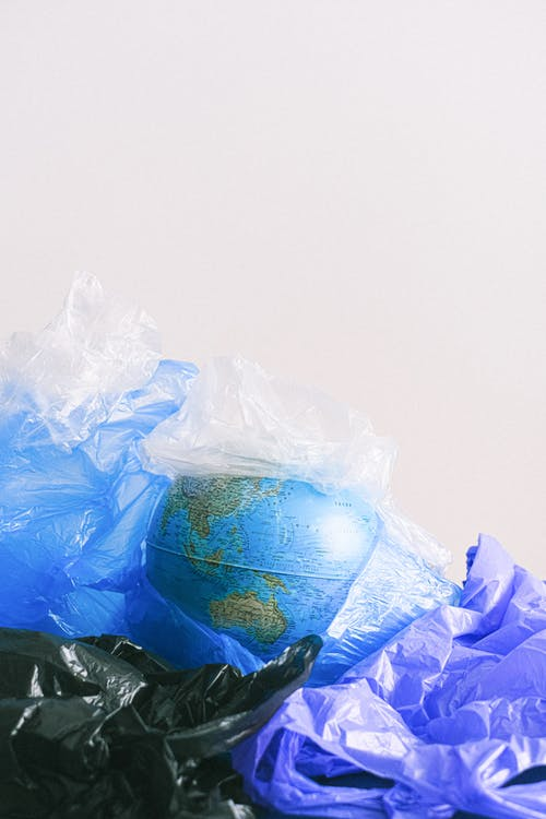 A Globe Surrounded by Plastic Bags