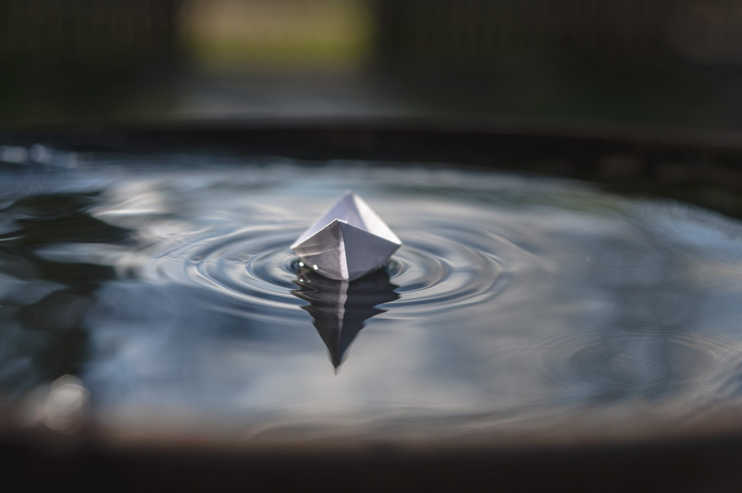 White Paper Boat on Floating on Water
