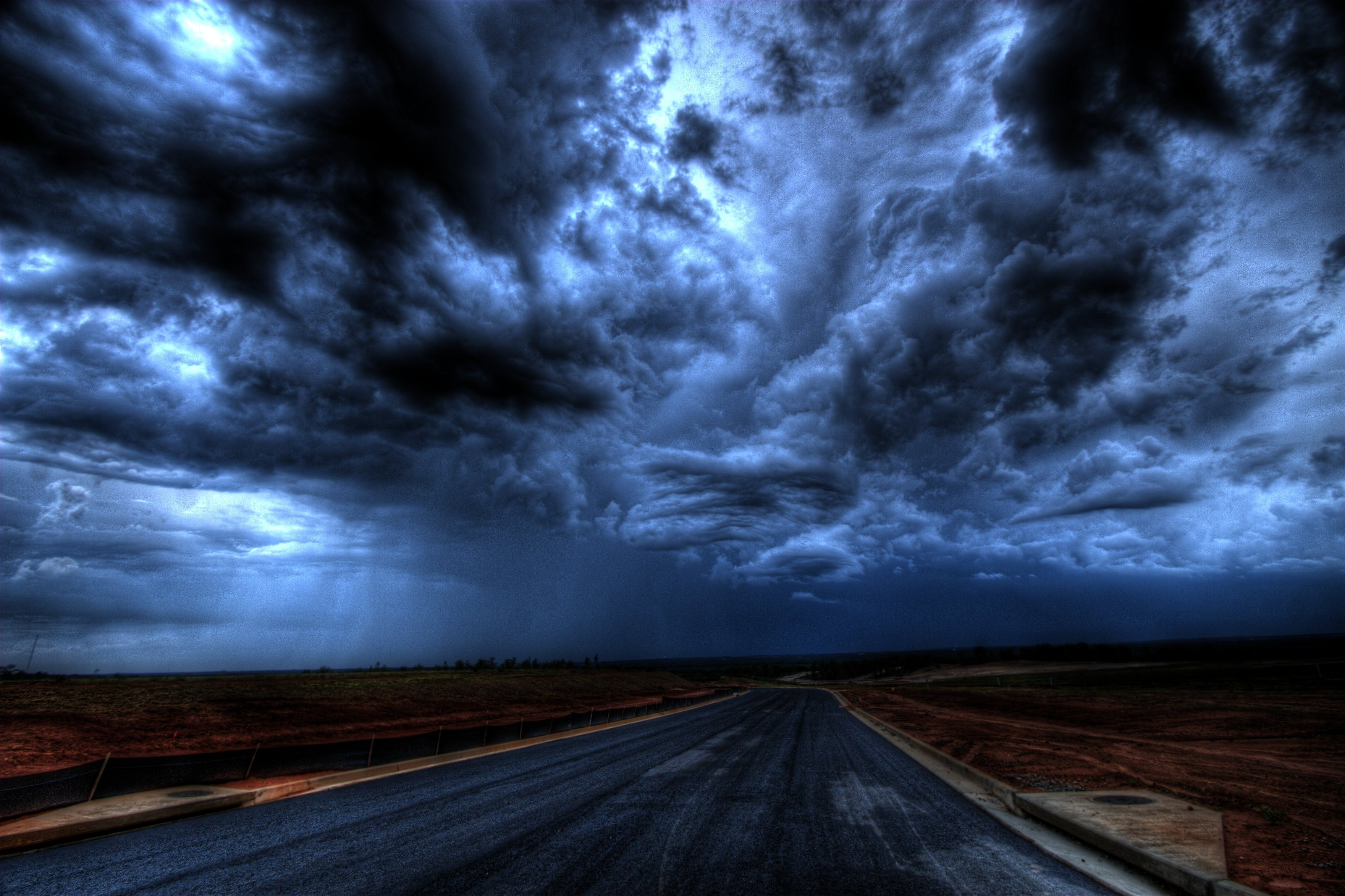 Asphalt Road Under Gray Clouds