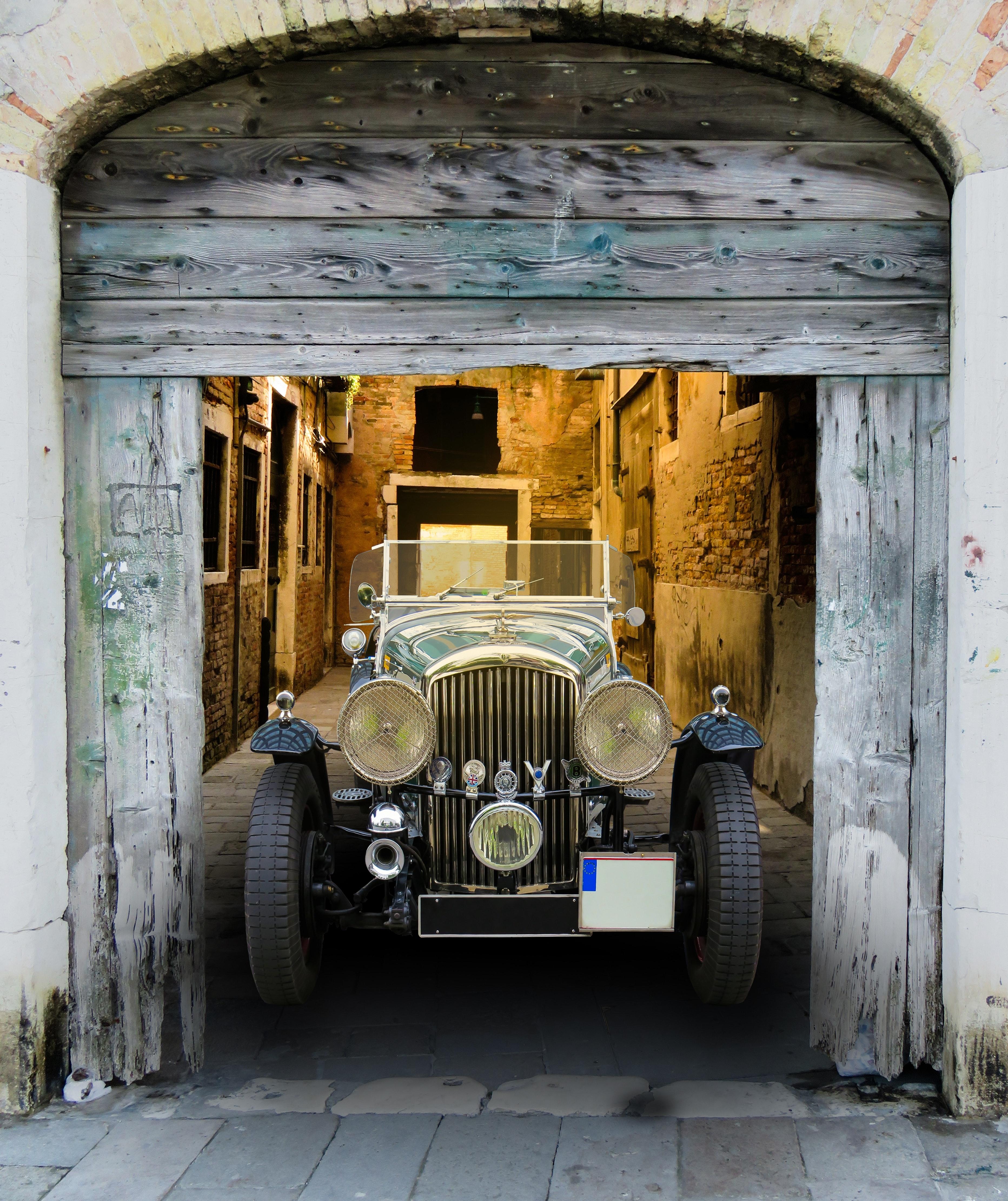 black classic car inside the garage  u00b7 free stock photo