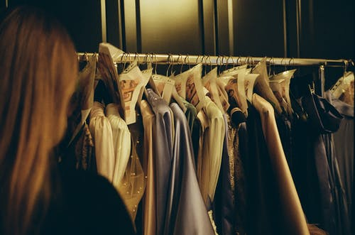 White and Brown Clothes Hanging on White Metal Rack