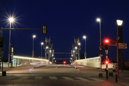Time-lapsed Photography of White Lights in Road