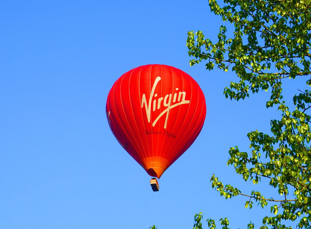Red Hot Air Balloon on Mid Air Under Blue Sky