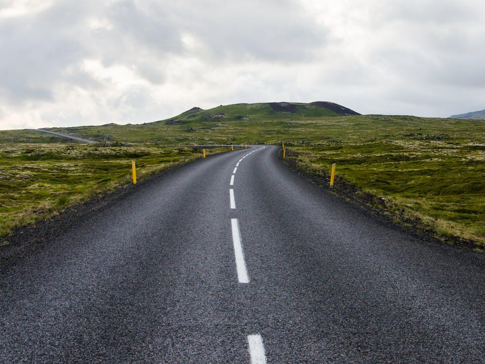 Gray Concrete Road Towards Green Mountain