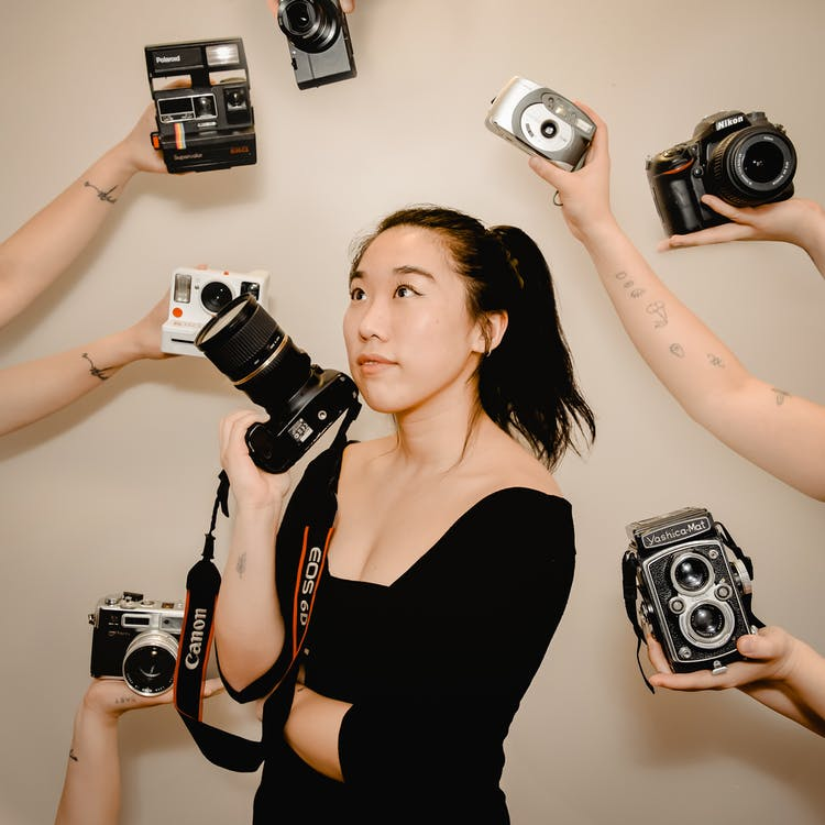 Asian woman with photo camera in hand