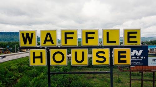 Street signboard of modern cafeteria on roadside