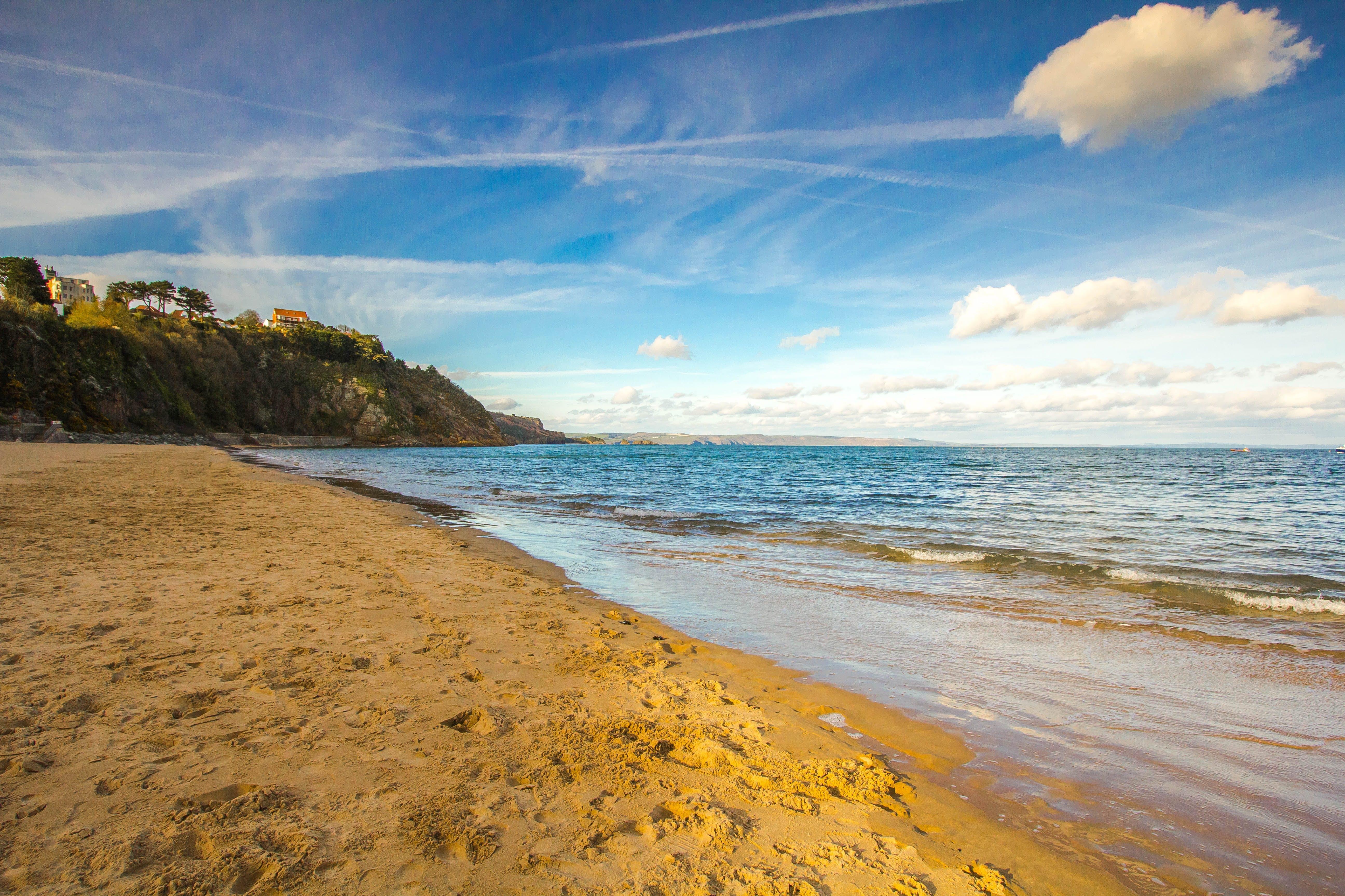 Seashore Under Blue Sky