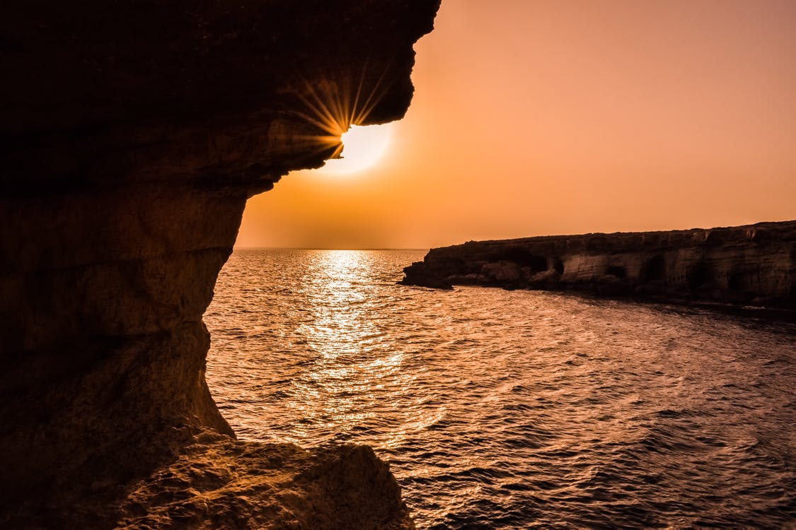 Cyprus holidays travel. A look at a stunning sunset over the sea.
