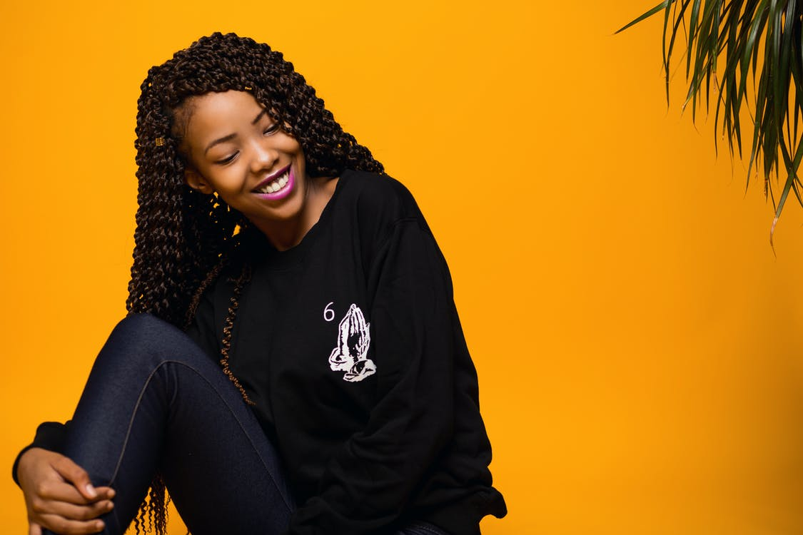 Content young black female model smiling in studio