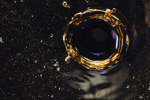 Droplet splashing on black water surface