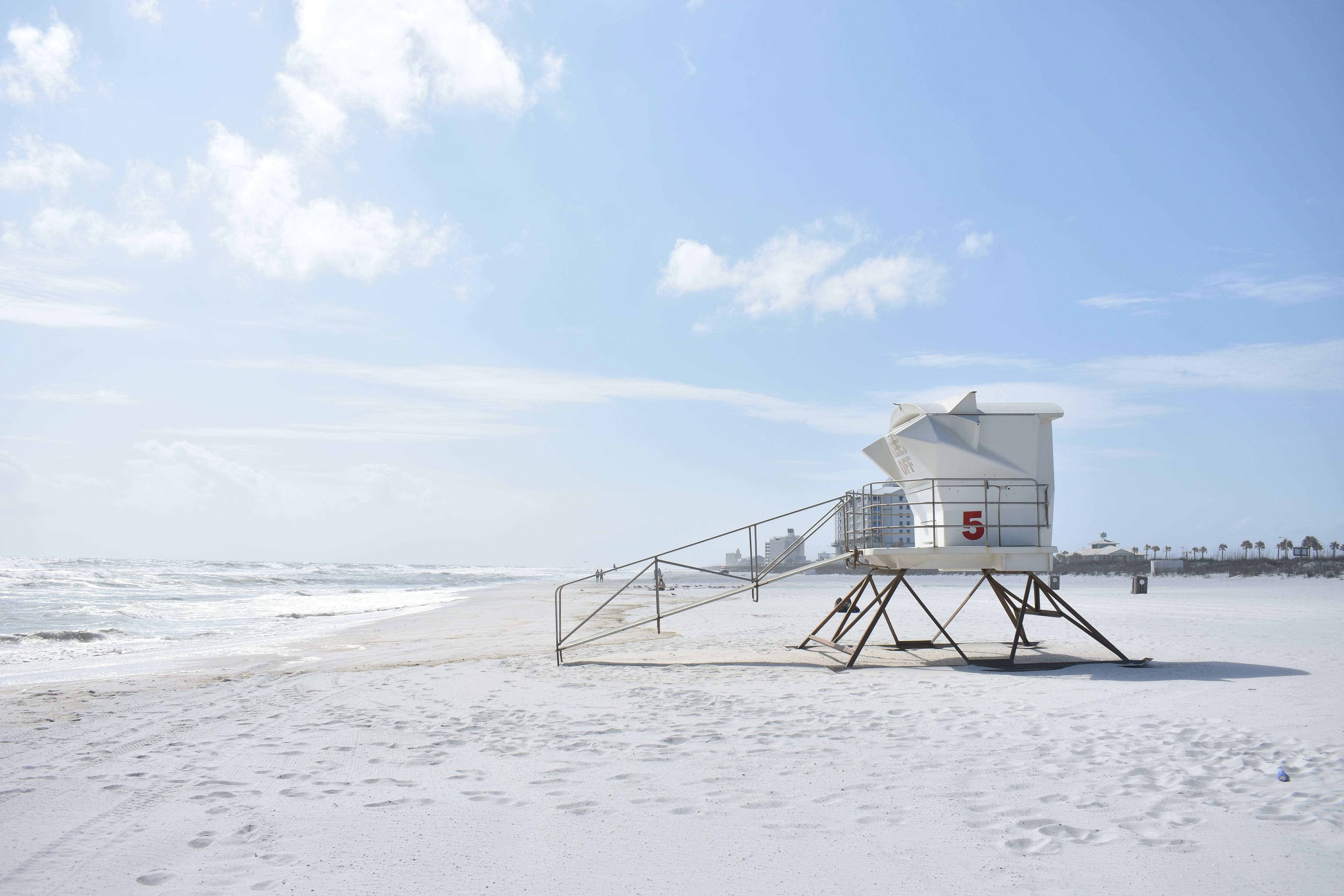 Photography of White Lifeguard House on Beach Resort