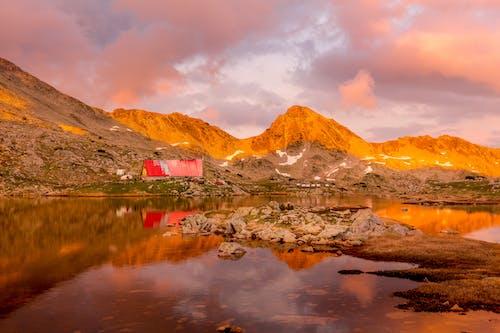 Kostnadsfri bild av apelsin, bakgrund, berg, bergskedja