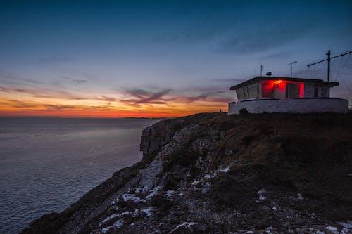 Photos gratuites de angleterre, aube, bâtiment, bord de mer