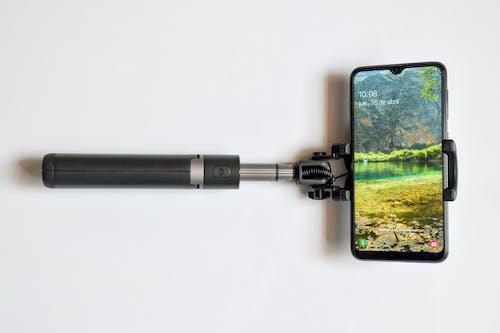 Close-Up Shot of a Smartphone on a Selfie Stick