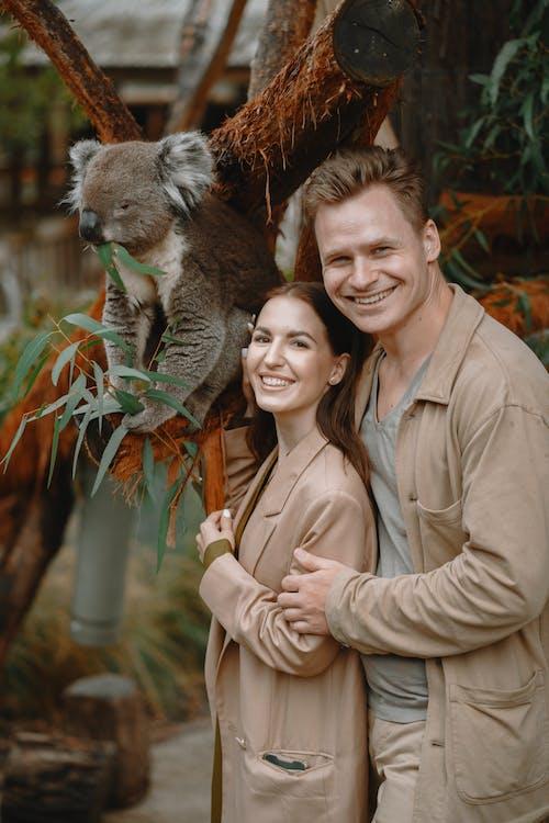 Happy hugging couple with funny koala