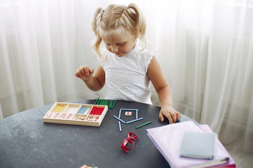 Little girl playing with puzzle