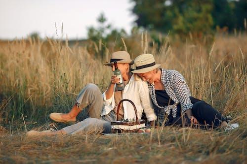 Loving female couple enjoying romantic picnic
