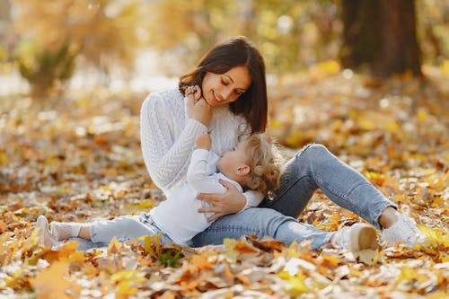 Happy mother and daughter hugging in park