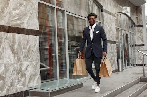 Elegant man walking with shopping bags