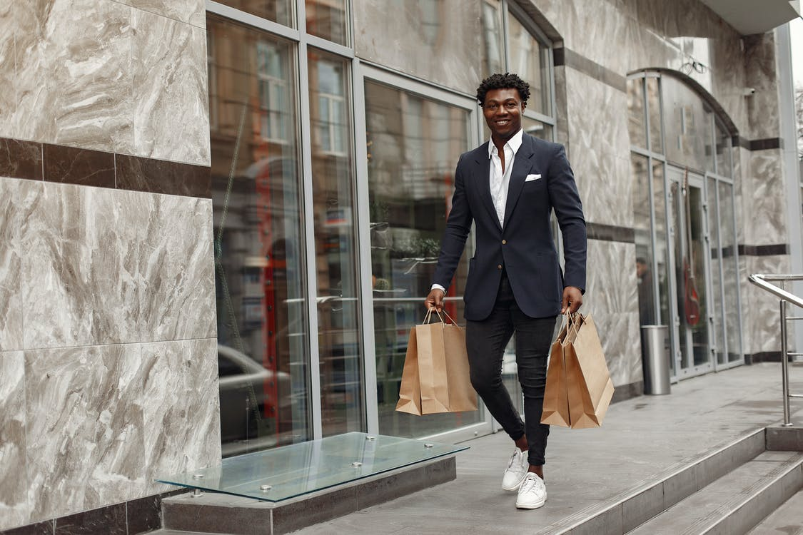Elegant man walking with shopping bags