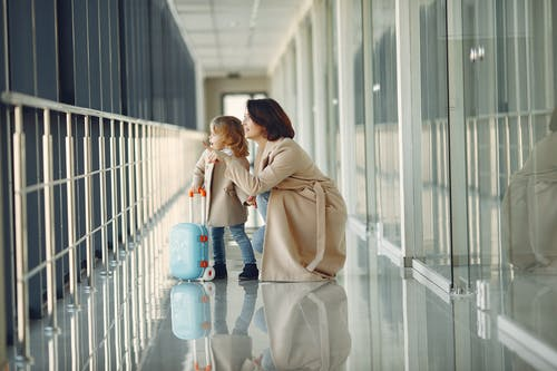 Amazed daughter and mother in airport hallway