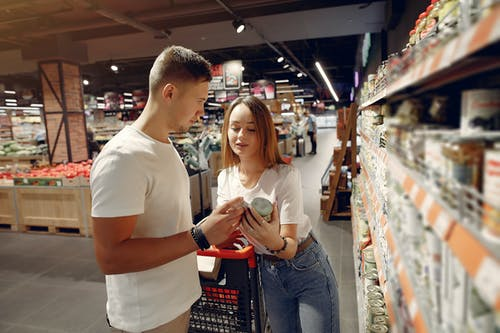 Young couple selecting food in market