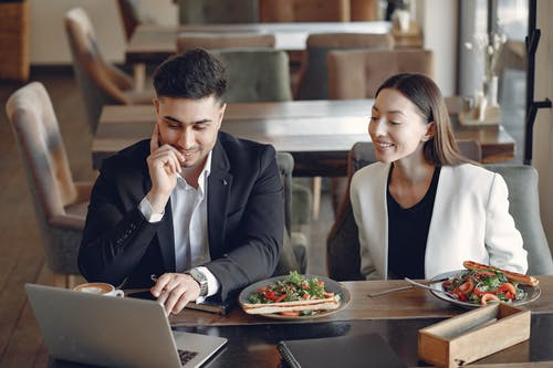 Positive diverse businesspeople working in cafe